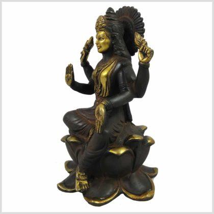 Lakshmi sitzend auf Lotus braungold Seitenansicht links