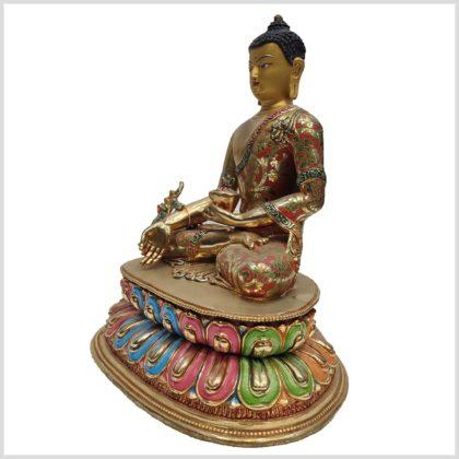 Medizinbuddha auf Podest Seitenansicht